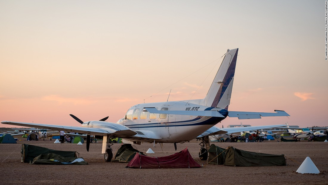 "The local airstrip, which lies largely empty for most of the year becomes an arrivals lounge and impromtu campsite rolled into one. <br /><br />""People fly by light plane,"" explains Jo McKinnon from the Birdsville Race Club. ""The airstrip is right alongside the pub. Some people even camp under the wings of their plane or sleep in them."""