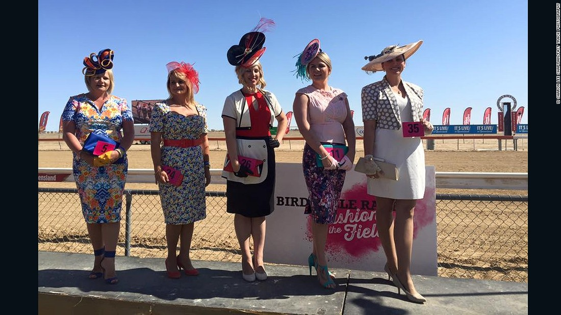 Ladies pose for a photo beside the Birdsville racetrack -- a welcome splash of color amid a sea of scrub and dirt.
