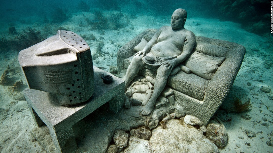 The artist makes the scuptures in Cancun, as heavy as possible so they would stay on the seabed once secured. Works are made of PH neutral cement, and over time sponges and coral encrust the surfaces in myriad of colorful and unexpected patterns.