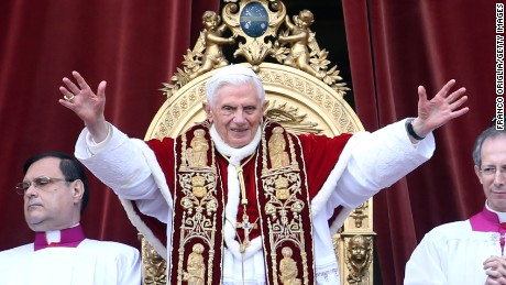 Pope Francis' economic message is no different than his predecessor, Pope Benedict XVI, above, Catholic commentators say, but some critics call Francis a Marxist.