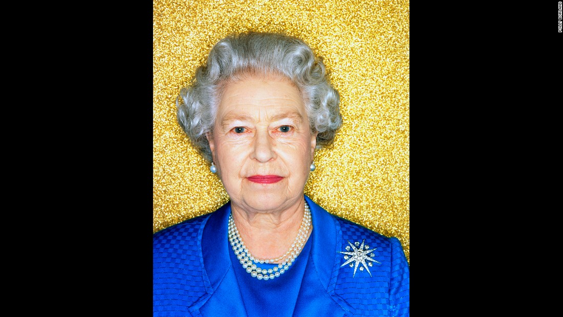 "Borland created a sparkly gold backdrop because the photo shoot was in what she called the most boring room in Buckingham Palace. ""I wanted a more modern take on the Queen,"" she said. ""A much more Andy Warhol-type portrait, something a bit pop art. ... Also it was the Golden Jubilee, so it was a literal intepretation."""