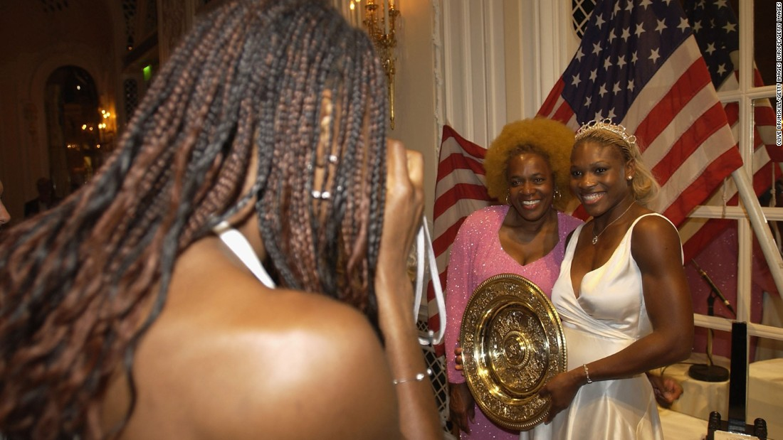 Venus snaps a photo of Serena and their mother at the Wimbledon Champions Dinner.