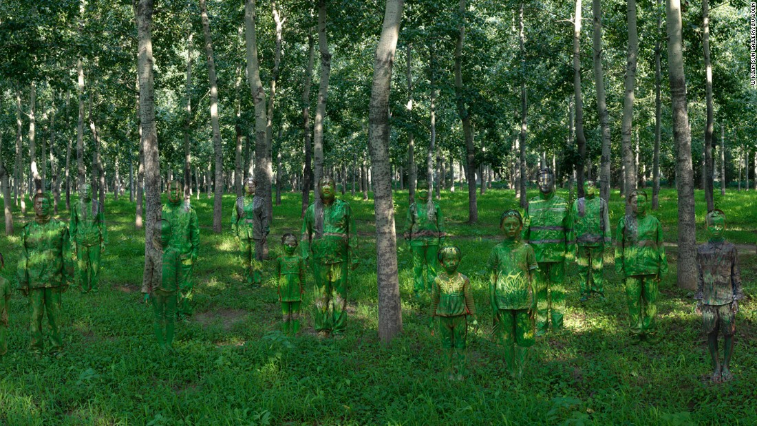 In this piece, Liu vanishes into a forest of tall birch trees. Can you spot him? <br />