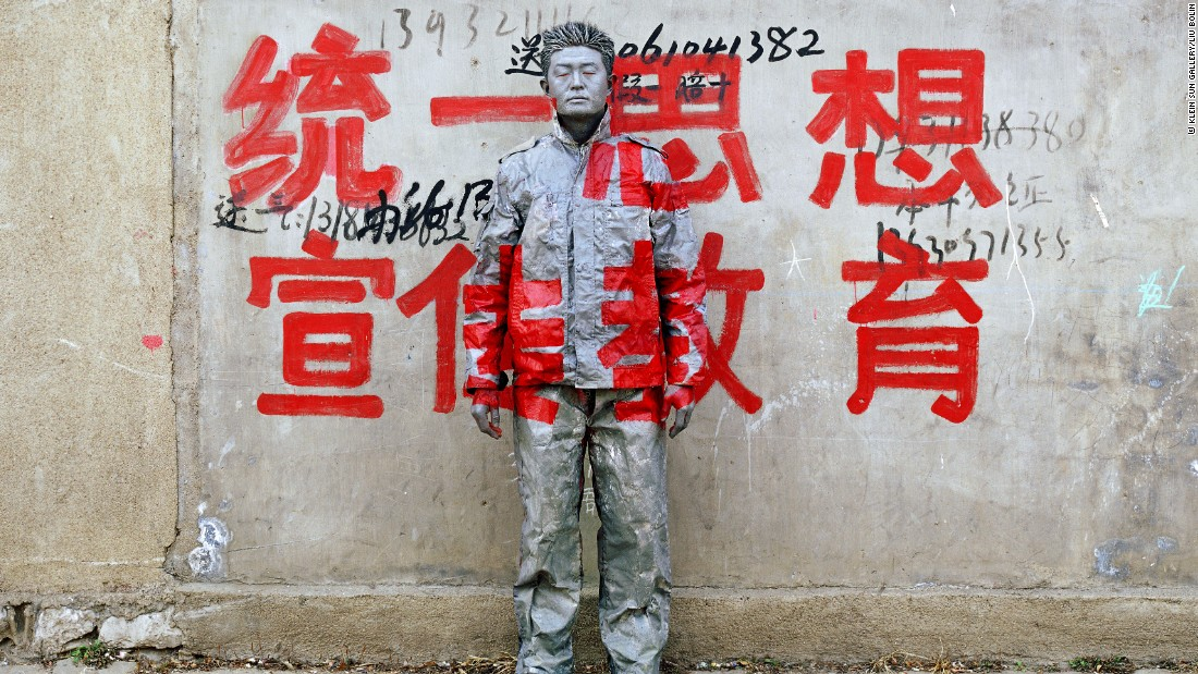 Big, four-character red slogans are commonly found throughout China. They are used to spread propaganda and political messages. <br />