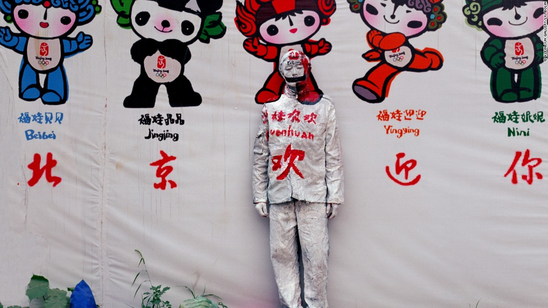 In an early work from 2006,  Liu painted himself to match the background of 2008 Beijing Olympics mascots that began appearing throughout the city. Huge swaths of the city's old hutongs were torn down to make way for the event.