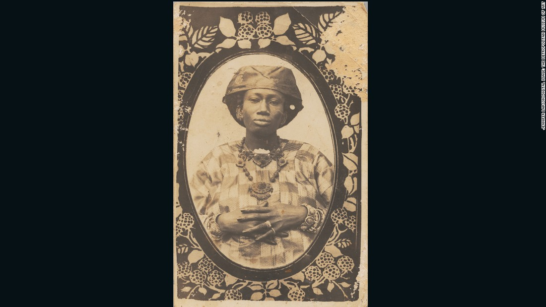 A cheaper alternative to a cabinet card or the older carte-de-viste, postcards such as this were printed directly from the negative and were far more likely to be bespoke rather than mass produced.<br /><br />Senegalese Woman, 1910s<br />Unknown Artist (Senegal)<br />Postcard format gelatin silver print