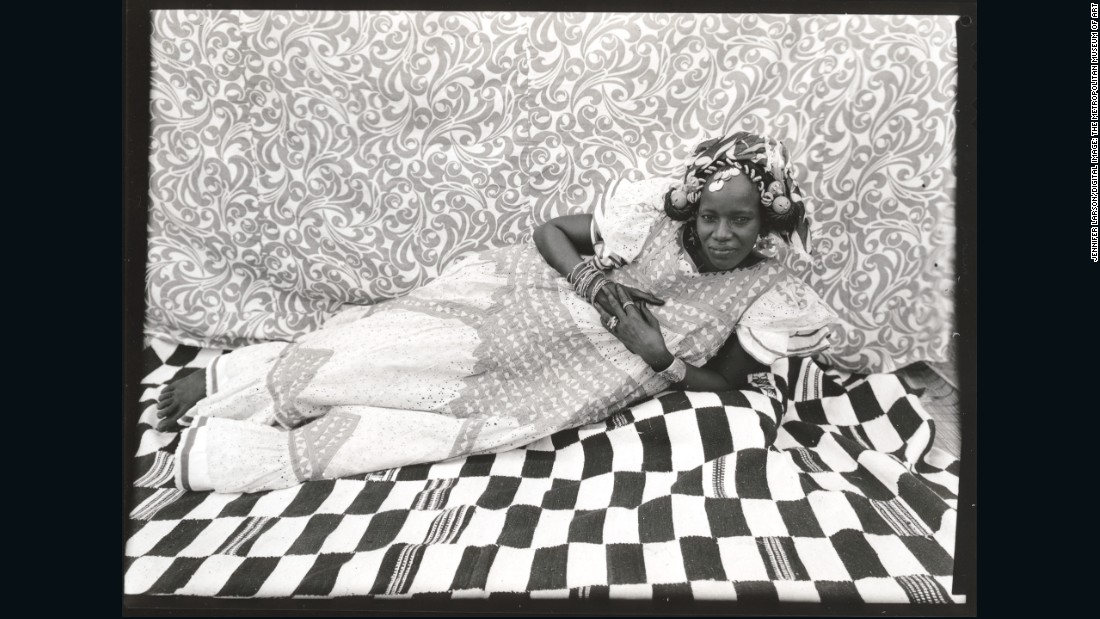 According to Biro, this woman poses in a relaxed way as to display her sociability and better show off her elegant dress.<br /><br />Reclining Woman, 1950s-1960s<br />Seydou Keita (Malian, 1921/23 -- 2001)<br />Gelatin silver print, 1975