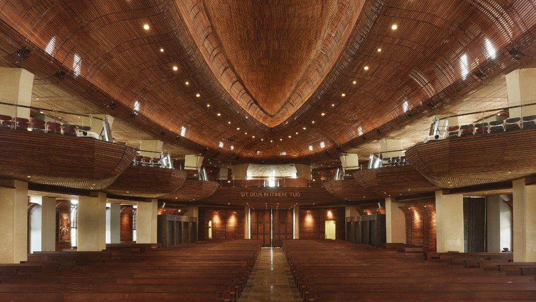 This catholic church was designed to seat up to 500 people in its canoe-like balconies. Natural materials such as stone and timber are used throughout the design.