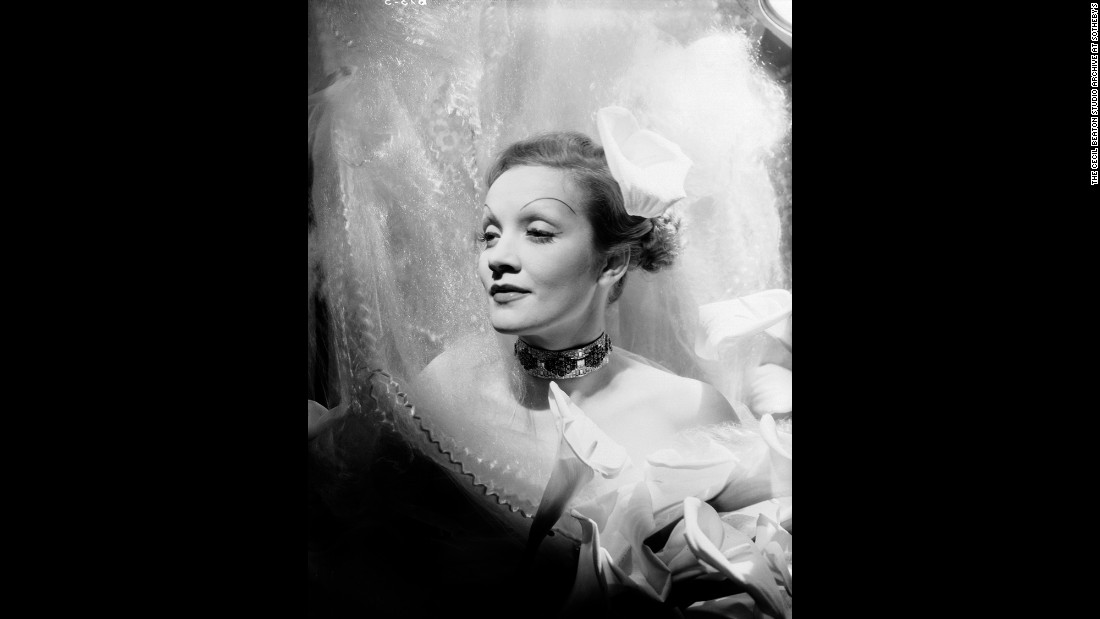 Nevertheless, his portraits were rarely less than respectful -- and even playful. Marlene Dietrich, photographed in 1935, looks like a Renaissance vision despite the unfortunate eyebrows.