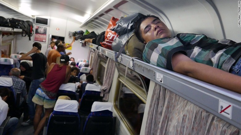 Hungarian camerawoman trips, kicks migrant