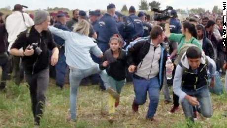 Hungarian camerawoman Petra Laszlo is seen kicking a child at a camp near Roszke, Hungary.