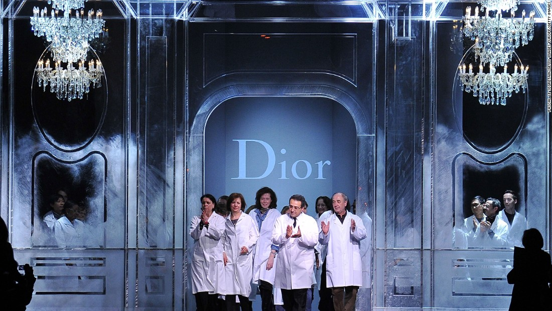 Dior closed the somber show by welcoming their seamstresses and tailors to the catwalk for the final bow. Attention was shifted from Galliano's departure to Dior's workforce.