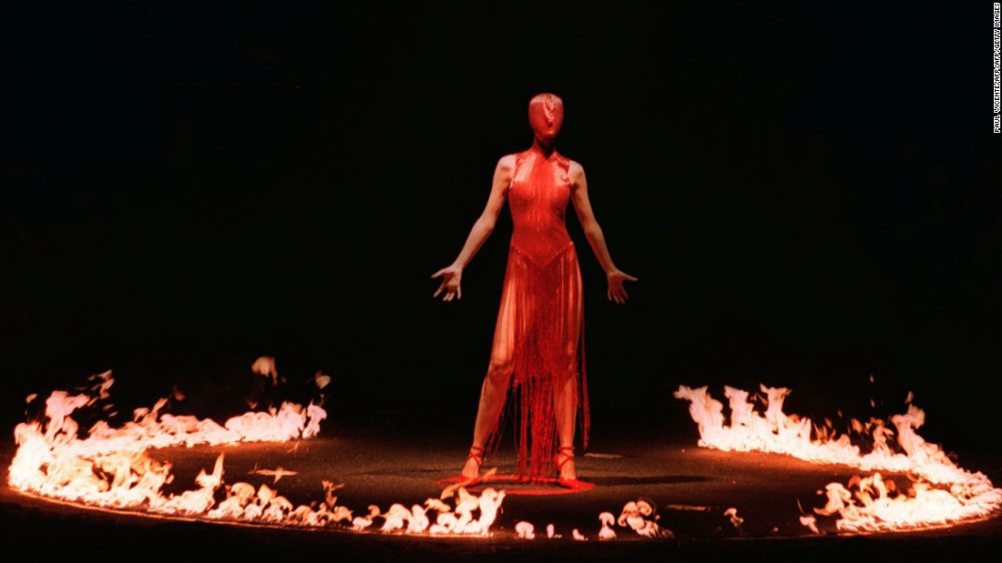As a theatrical finale for his fall/winter show in 1998, Alexander McQueen sent a masked model down a dimly lit runway. Once she walked to the center of the stage, a ring of fire was lit around her.