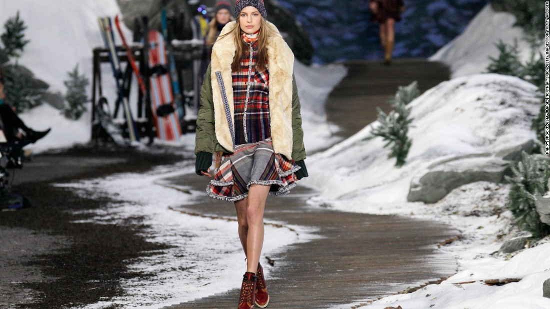 Tommy Hilfiger's fall/winter 2014 show was fully inspired by the great American outdoors. He filled the stage with fake snow, ski props and little pine trees.
