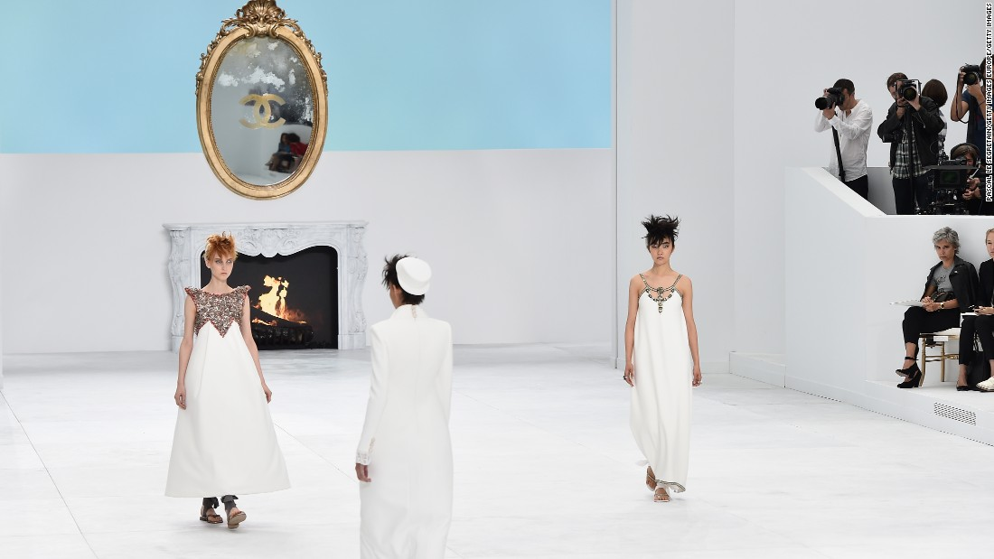 "Chanel's fall/winter 2014 set in Paris was inspired by famed architect Le Corbusier. The set was in reference to Corbusier's work on a rooftop garden designed for multi-millionaire art collector Carlos de Beistegui. The production and the collection itself were both dubbed ""Le Corbusier goes to Versailles."""