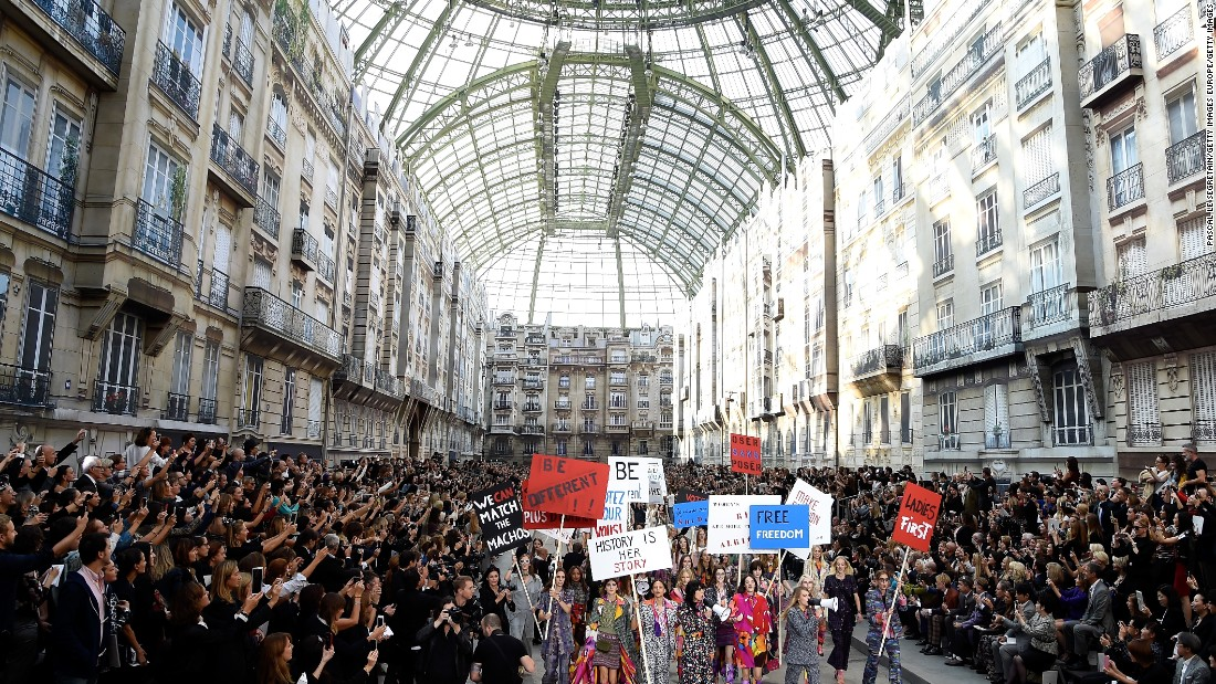 Chanel's spring/summer 2015 show converted the Grand Palais into a Parisian Boulevard, complete with small townhouses. As part of the show, the fashion house staged a street protest.