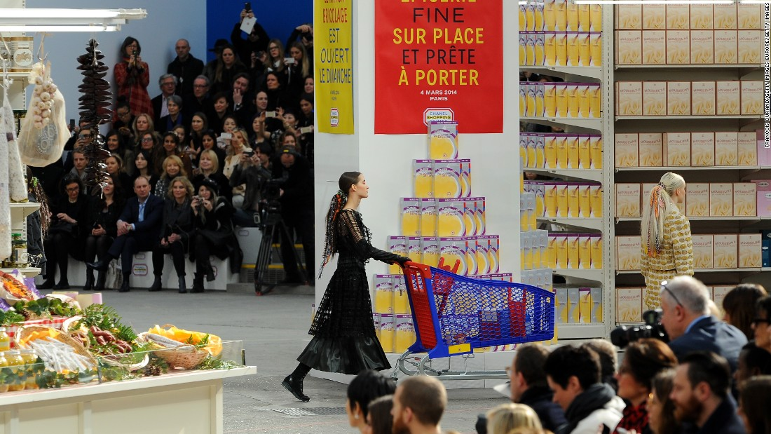 Models toted Chanel shopping bags and grocery carts, and proceeded to wind up and down the catwalk aisles while sifting through different Chanel-branded grocery items.