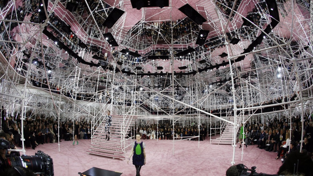 With Raf Simons taking over the role of creative director, Dior's spring/summer 2015 collection was revealed against a hectic backdrop of scaffolding and mirrors.