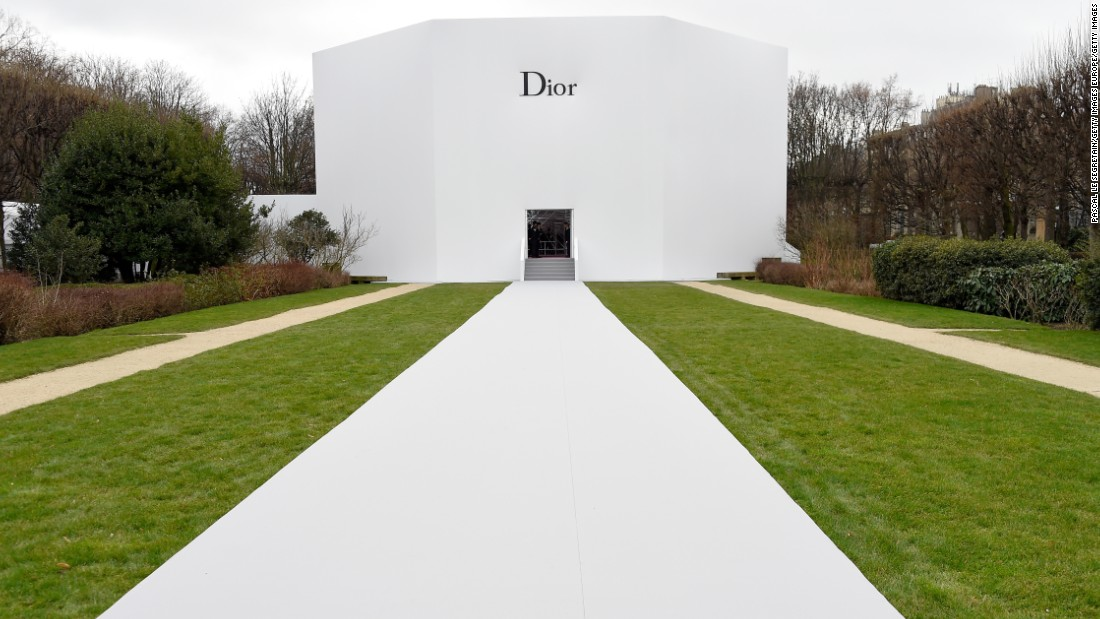 In contrast to its busy interior, the all-white exterior of the Dior spring/summer 2015 set popped out against the greenery of its Parisian garden backdrop.