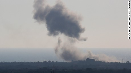 A picture taken from the Rafah border of the southern Gaza Strip with Egypt shows smoke billowing in Egypt's North Sinai on July 16, 2015. Earlier today the Islamic State jihadist group said it carried out a missile attack on an Egyptian navy vessel off North Sinai, the first such incident in a two-year insurgency. AFP PHOTO / SAID KHATIB        (Photo credit should read SAID KHATIB/AFP/Getty Images)