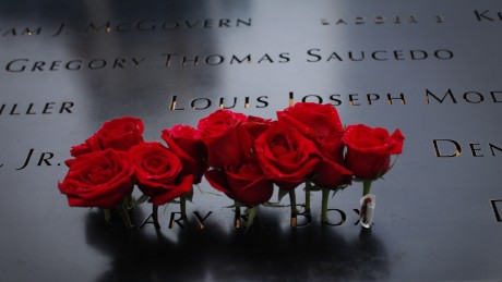 Roses are seen placed on the 9/11 memorial before the ceremony to commemorate the 14th Anniversary of the terrorist attacks, on September 11, 2015 in New York.    AFP PHOTO/KENA BETANCUR        (Photo credit should read KENA BETANCUR/AFP/Getty Images)