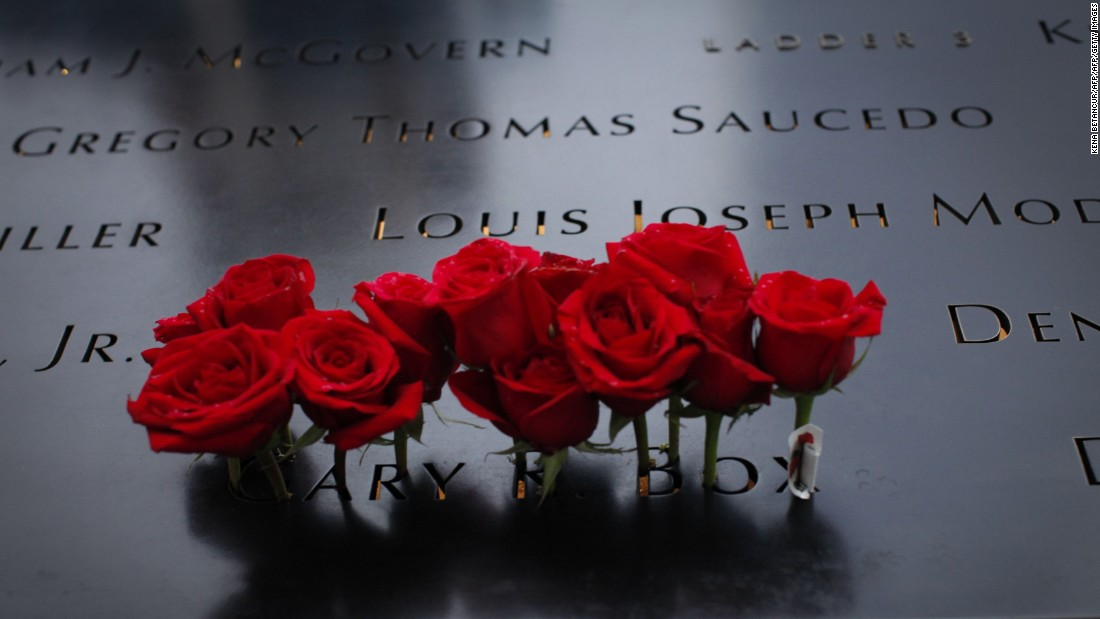 Roses are placed Friday at the National September 11 Memorial in New York before a ceremony commemorating the 14th anniversary of the attacks.