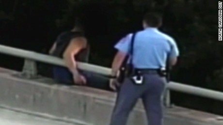 Cop bridge hug north carolina orig dlewis_00001101.jpg