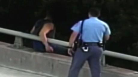Cop bridge hug north carolina orig dlewis_00001101.jpg
