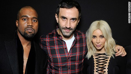 Riccardo Tisci (center) with Kanye West and Kim Kardashian