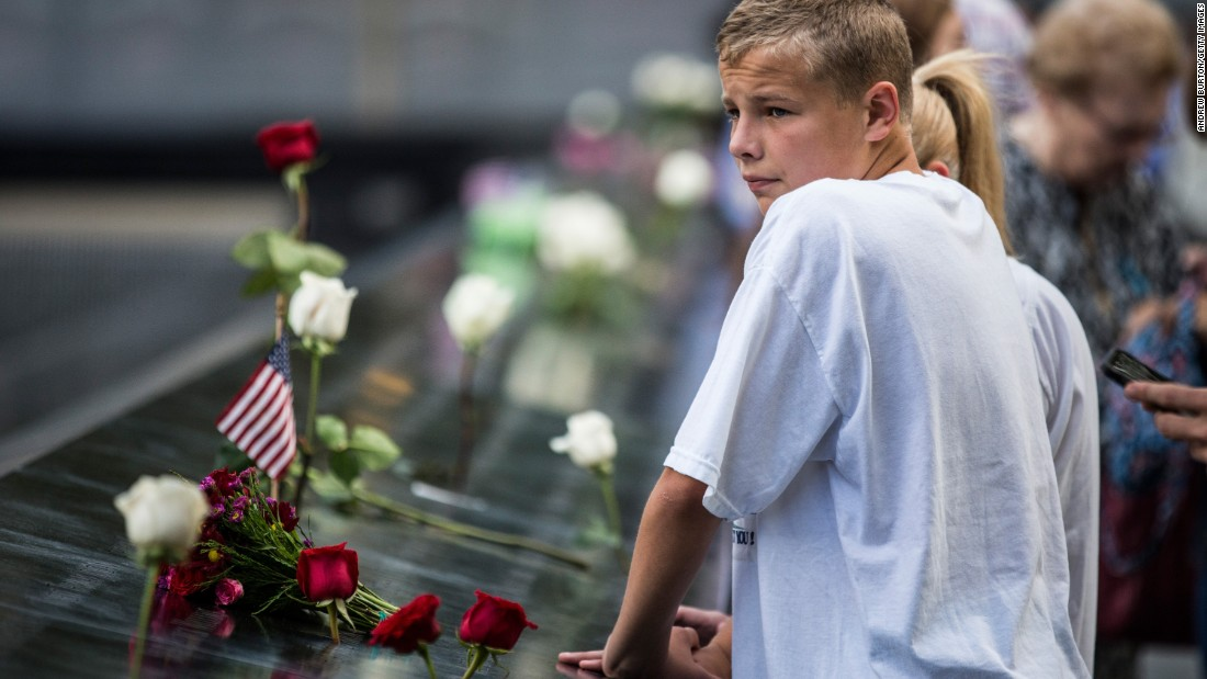 Gary Mascitis, 14, pays tribute to his uncle during an anniversary ceremony for the attacks in New York. Two hijacked planes hit the World Trade Center on 9/11. A third plane crashed into the Pentagon outside Washington and a fourth into a Pennsylvania field.