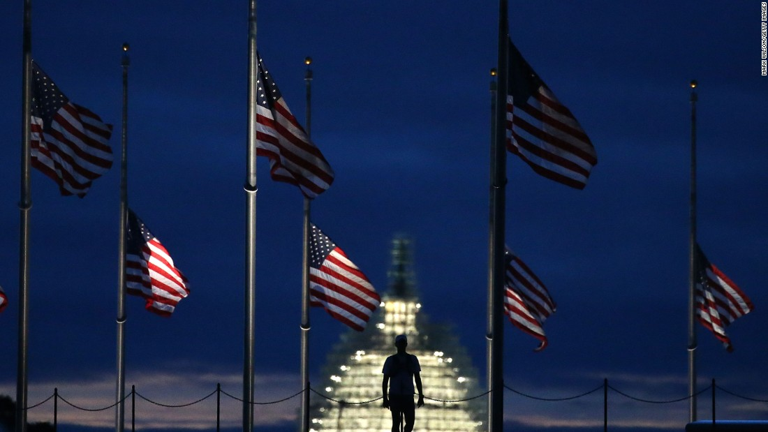 American flags are lowered to half-staff at the Washington Monument on September 11.