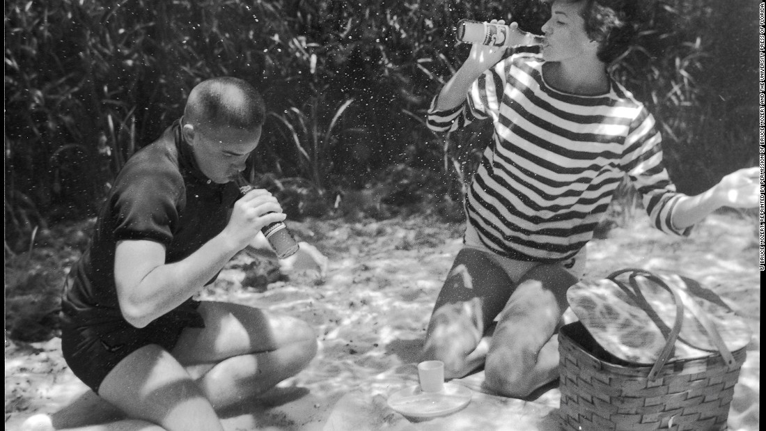 "Monroe points out that Mozert's attention to detail and experimentation with props and materials allowed for each underwater photo to so perfectly reflect the on-ground scene it was depicting. ""Tiny fishing weights ensured that the hula dancer's grass skirt wouldn't float upwards, the bubbly in the glass of champagne resulted from Alka-Seltzer tablets, the smoke from the barbequing steak was made from condensed powdered milk."""