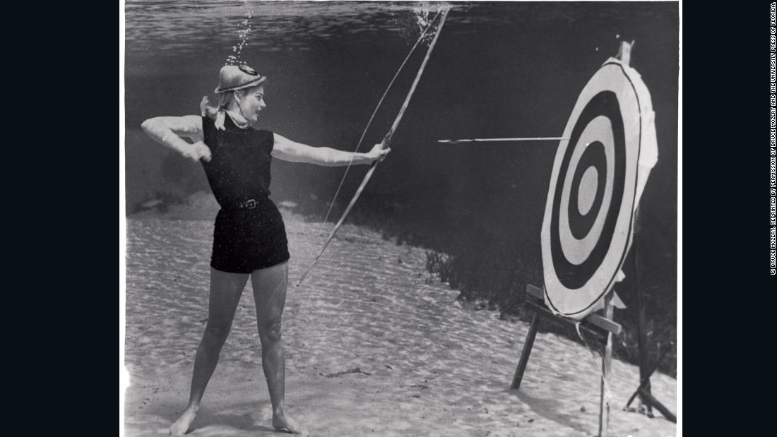 "Even for an image such as this one, Mozert and his team tested materials and props underwater before taking the photograph. ""They tested the effect of the current on the arrow as it left the archer's bow -- she had to hit the target. No air hoses are visible in these photographs (with slight exception, they were not used). Silver Springs required something else -- the illusion of verity was key."""