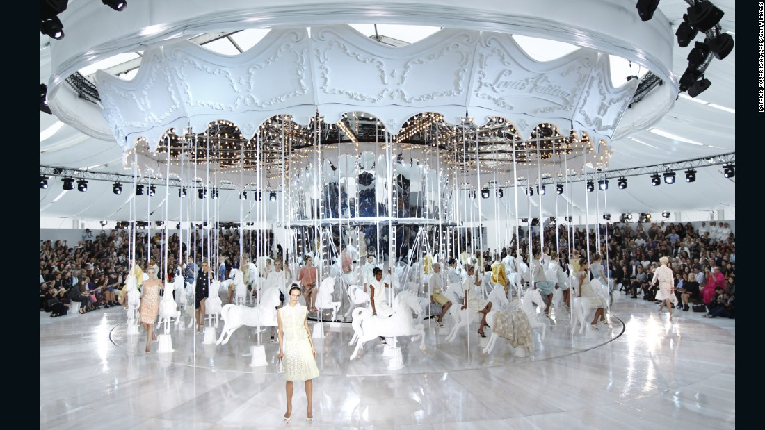 Another production by Marc Jacobs, the curtain at this Louis Vuitton show was lifted to reveal a giant all-white carousel, with models perched on every horse.