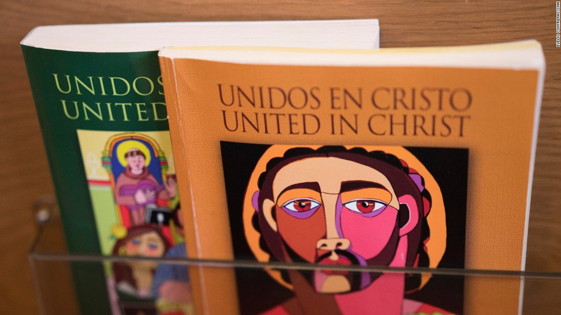 "Long before Saint Charles Borromeo celebrated its first Mass entirely in Spanish, Msgr. Edward Deliman ordered bilingual books for the pews. ""We introduced it as just something for the people to see,"" he says."