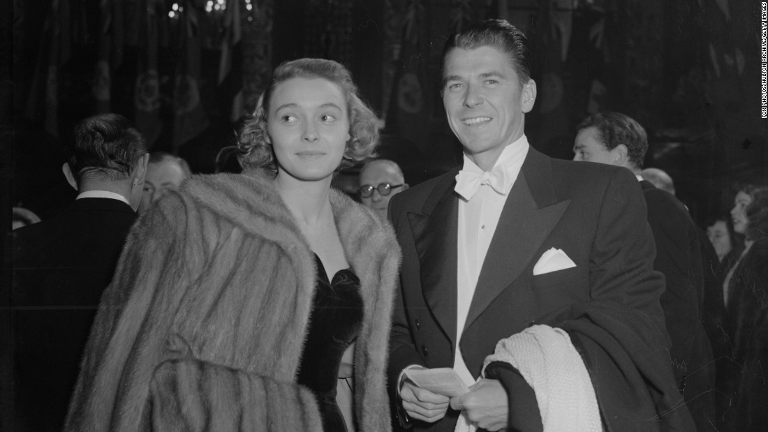 "Reagan appears with Patricia Neal on November 20, 1948, at the Royal Command Film Performance of ""Scott of the Antarctic"" at the Empire Theatre, London."