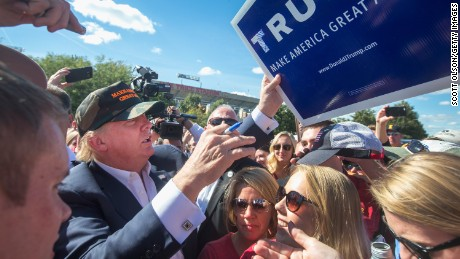 Republican presidential candidate Donald Trump greets fans tailgating outside Jack Trice Stadium before the start of the Iowa State University versus University of Iowa football game on September 12, 2015 in Ames, Iowa.