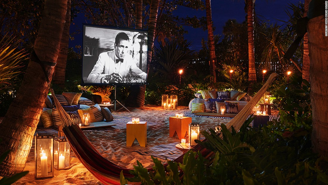 "<a href=""http://www.venuereport.com/roundups/22-incredible-outdoor-cinemas-worldwide/entry/2/"" target=""_blank"">The Miami Beach Edition Hotel's</a> sleek and modern seaside tropical hideout is outfitted with hammocks, low-lying beds and a huge outdoor movie screen, where guests can watch movies under the stars."