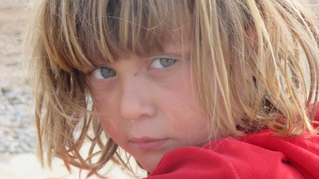 My name is Safiya. I am 14 years old. I took this photo in the camp. This photo is my favorite. There is fatigue in her face. Her face expressed tiredness.