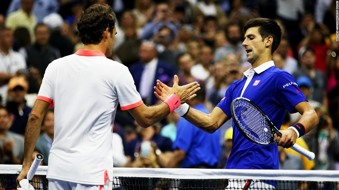 Djokovic shakes hands with Federer after winning his 10th grand slam title, avenging his defeat to the Swiss eight years ago.