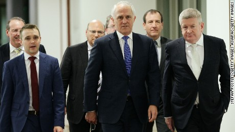 CANBERRA, AUSTRALIA - SEPTEMBER 14:  Minister for Communications Malcolm Turnbull and supporters arrive at the Liberal party room for the leadership ballot at Parliament House on September 14, 2015 in Canberra, Australia. Malcolm Turnbull announced this morning he would be challenging Tony Abbott for the Liberal Party leadership.  (Photo by Stefan Postles/Getty Images)