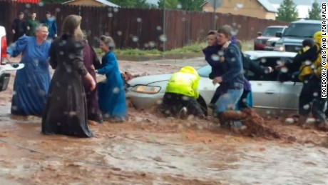 Rescuers try to help those stuck in a submerged car in Hildale, Utah.