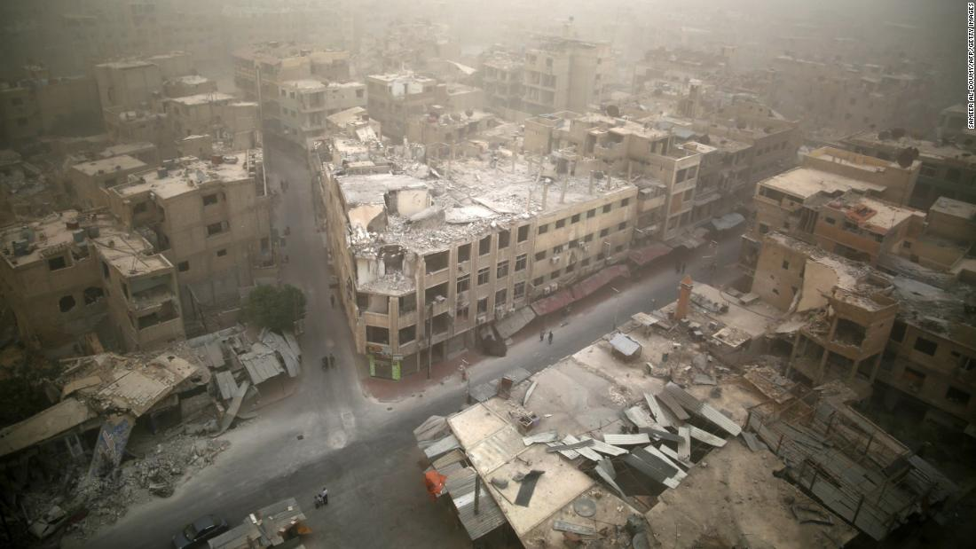 A sandstorm blows over damaged buildings in the rebel-held area of Douma, east of Damascus, on September 7, 2015.