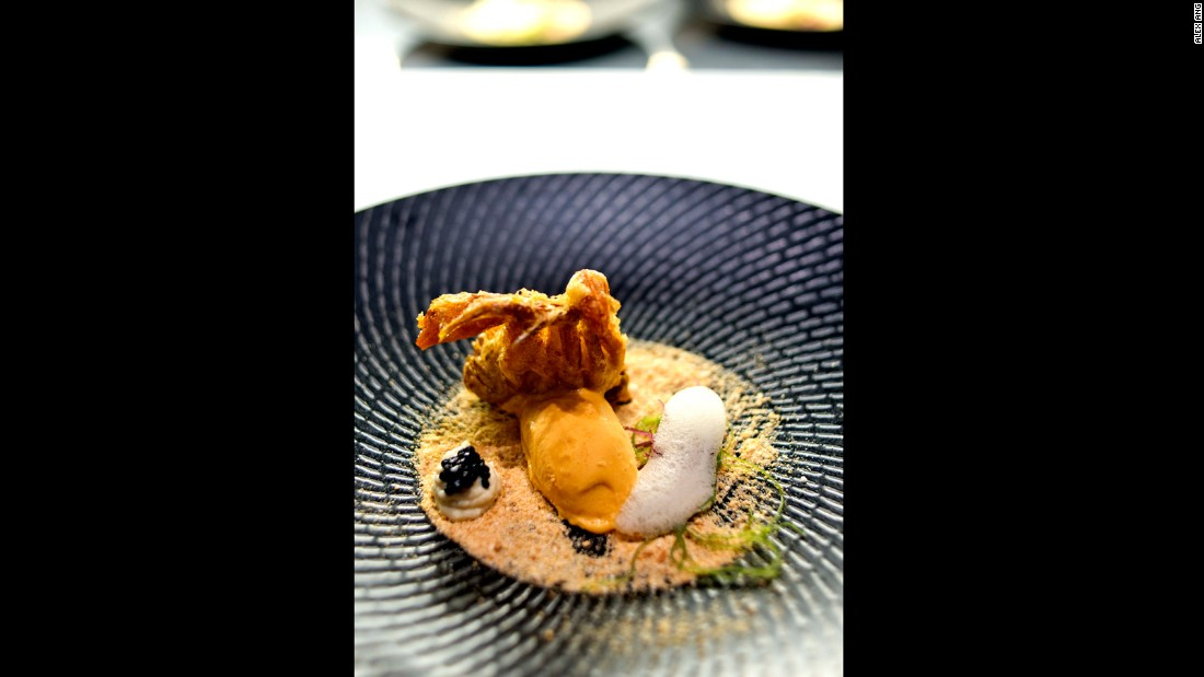 "This modern Singapore cuisine restaurant is arguably the most inventive among the newcomers. Chef Han Li Guang's version of chili crab is a deep-fried soft shell crab served with spicy chili crab ice cream and ethereal crab bisque foam. These are placed on a ""beach"" of man tou crumbs."