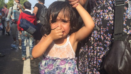 A girl cries after Hungarian police use tear gas and water cannons on migrants at the border.