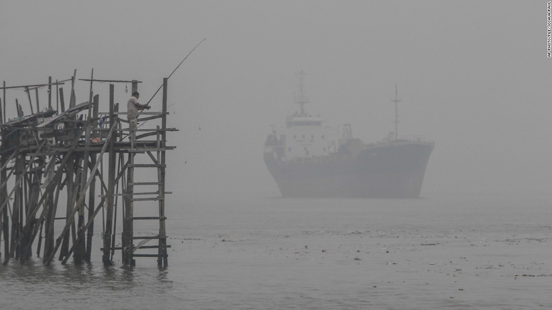 A man fishes in haze-hit Port Klang, outside Kuala Lumpur, on September 13.