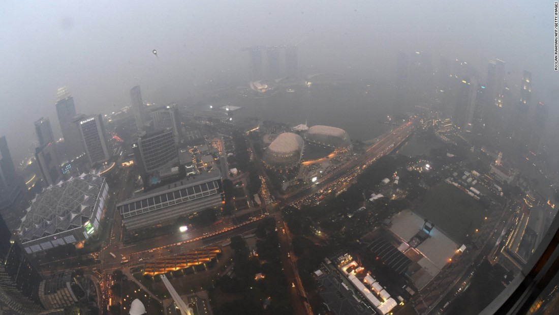 City lights pierce through the dense haze in Singapore on September 14, 2015.