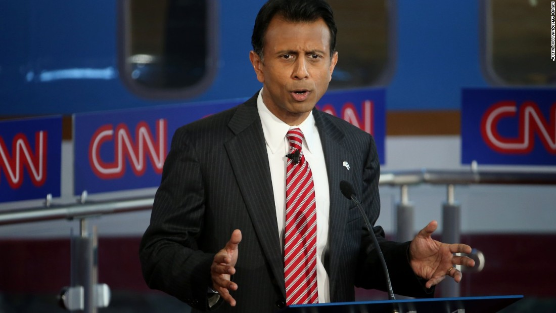 "Jindal answers a question during the debate. At the beginning, he told moderator Jake Tapper that he didn't violate the so-called ""11th Commandment"" of not going after your own party in his attacks on Donald Trump. ""Let's stop treating Donald Trump like a Republican,"" Jindal said of the Republican front-runner. ""He's not a conservative, he's not a liberal ... he believes in Donald Trump."""
