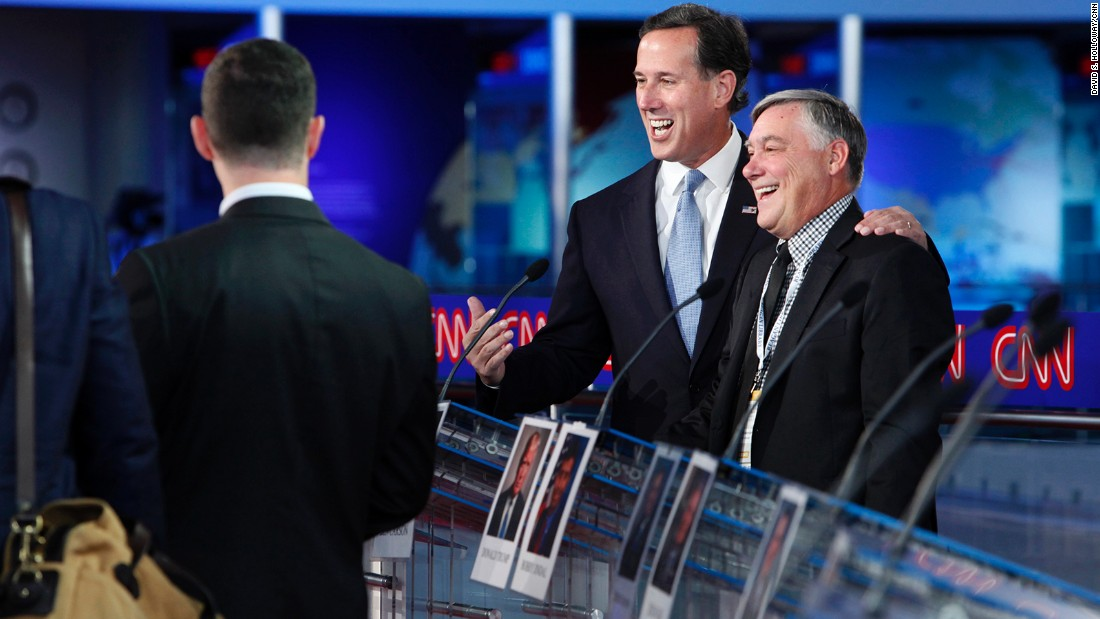 Santorum enjoys a light-hearted moment before the debate.