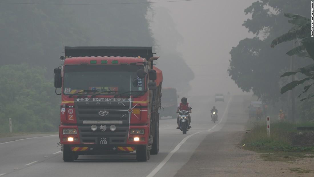 Motorists drive on a street in Karak, Malaysia, on September 15.